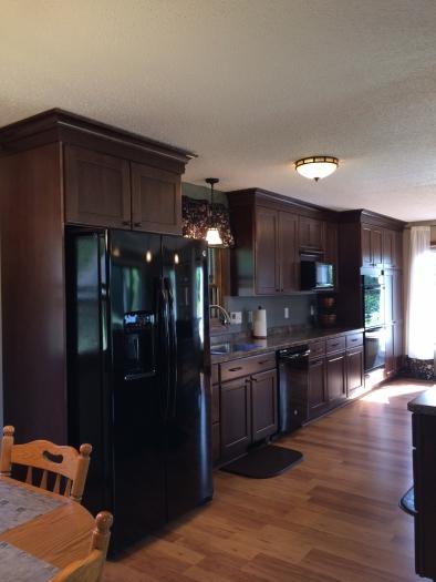 Merillat Cabinets. Ralston Door Style. Pecan On Maple. Formica Countertops:  Jamocha Granite With A Karran Undermount Kitchen Sink.